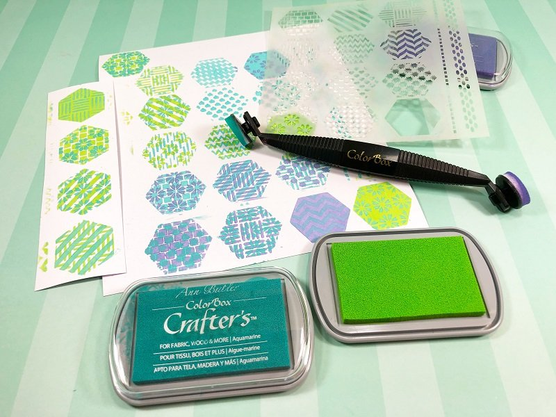 Layer the aqua, lime and lavender ink colors on the white paper using the hexagon stencil Creatively Beth #creativelybeth #annbutlerdesigns #cards #stencils #hexagons