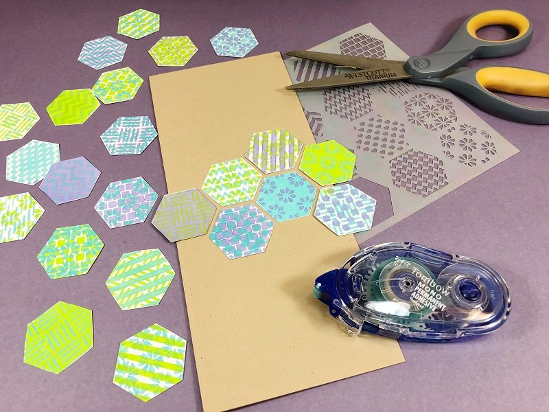 Cut out the hexagons and create a pattern and the attach to the card base with Tombow Adhesive Creatively Beth #creativelybeth #annbutlerdesigns #cards #stencils #hexagons