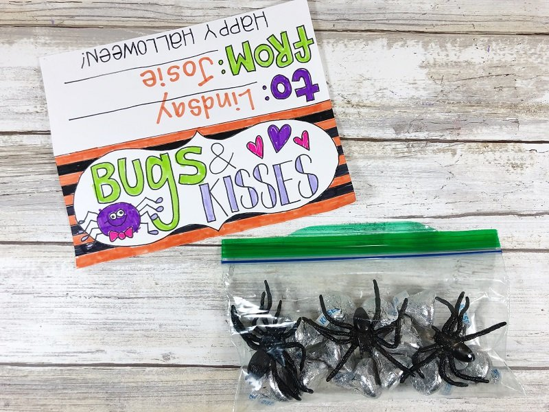 Fold the colored treat topper from Creatively Beth in half #freeprintable #halloween