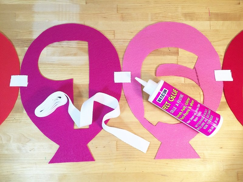 Attach the Happy Birthday Balloon Banner felt letters with ribbon and glue with Creatively Beth