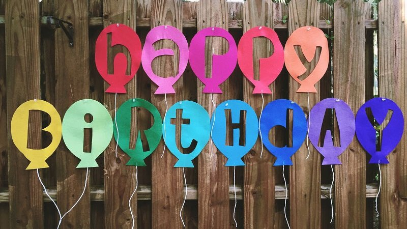 Reverse cut brightly colored Kunin Felt to create a Happy Birthday Balloon Banner with Creatively Beth