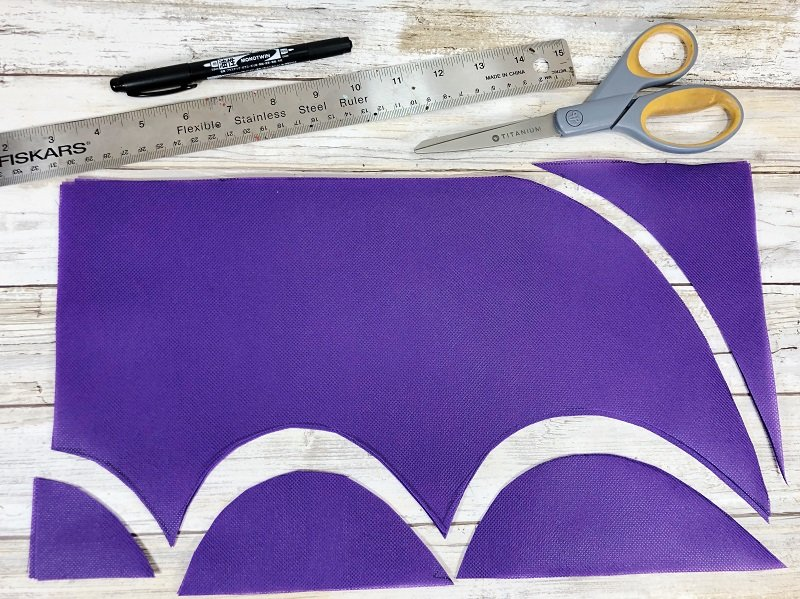 Creatively Beth create bat wings by cutting out scallops