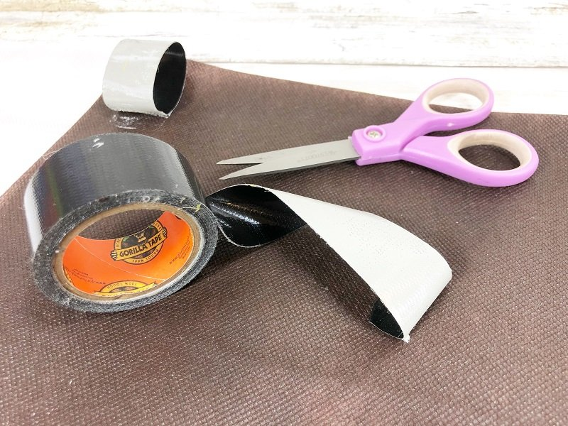 Creatively Beth attach strong adhesive tape to the back and attach to metal door frame or wooden gate