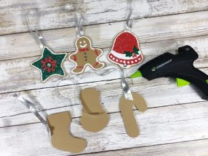 Attach ribbon hangers to Craft Foam Cookies #creativelybeth #dollartreecrafts #christmascookies #kidscrafts