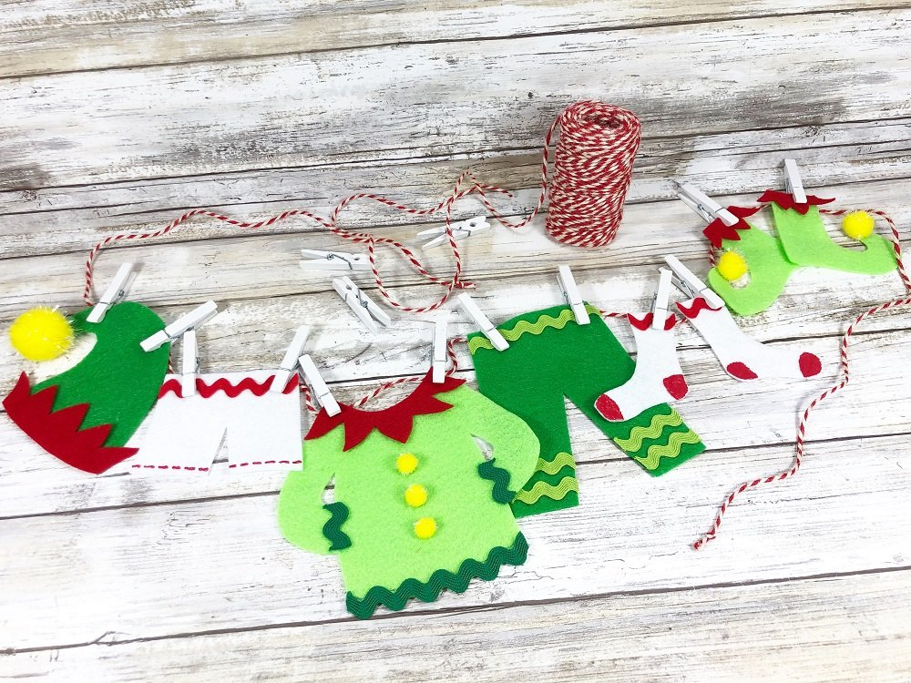 Hang Elf Clothes on the Line with Mini Clothespins #creativelybeth #createwithkunin #christmascrafts #feltgarland