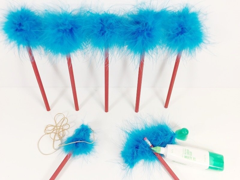 Glue feather boa around top of each pencil Creatively Beth #creativelybeth #catinthehat #drseuss #thing1andthing2 #kidscrafts