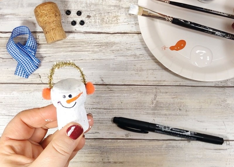 Add Features to the Snowman - Creatively Beth #creativelybeth #corkcrafts #snowmencrafts #recycled #dollartreecrafts