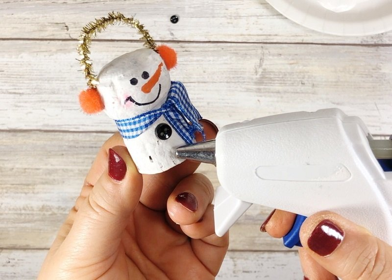 Glue on Buttons to Complete the Snowmen - Creatively Beth #creativelybeth #corkcrafts #snowmencrafts #recycled #dollartreecrafts