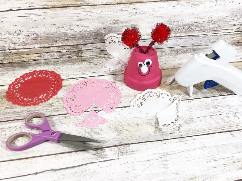 Paper Doily Wings Clay Pot Love Bugs Craft Creatively Beth #creativelybeth #dollartreecrafts #kidscrafts #claypotcrafts #valentinesdaycrafts