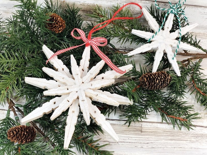 Create a Blizzard of Clothespin Snowflakes Creatively Beth #creativelybeth #dollartreecrafts #snowflake #quickandeasycrafts #wintercrafts