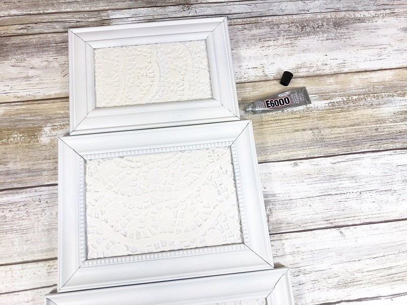 Stack frames and glue together Dollar Tree Picture Frame Snowman Creatively Beth #creativelybeth #dollartreecrafts #snowmancrafts #kidscrafts #wintercrafts