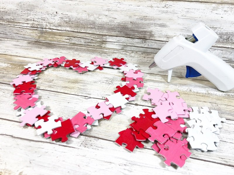 Add a second layer Puzzle Piece Heart Shaped Wreath Creatively Beth #creativelybeth #dollartreecrafts #heart #valentinesdaycrafts #kidscrafts