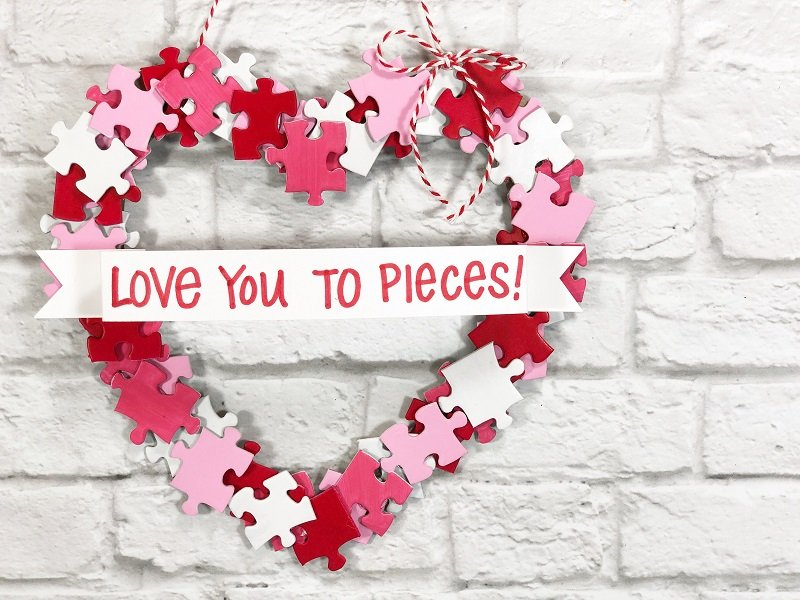 Puzzle Piece Heart Shaped Wreath Creatively Beth #creativelybeth #dollartreecrafts #heart #valentinesdaycrafts #kidscrafts