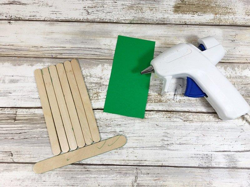 Attach Craft Sticks with glue to create Hat shape Creatively Beth #creativelybeth #kidscrafts #leprechaun #stpatricksday
