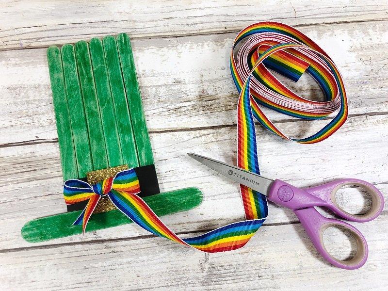 Add rainbow ribbon bow Creatively Beth #creativelybeth #kidscrafts #leprechaun #stpatricksday
