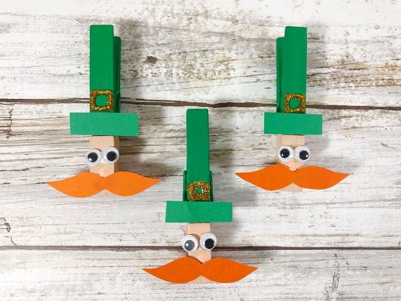 Add wiggle eyes, buckle and mustache Creatively Beth #creativelybeth #leprechauns #stpatricksdaycrafts #kidscrafts #dollartreecrafts
