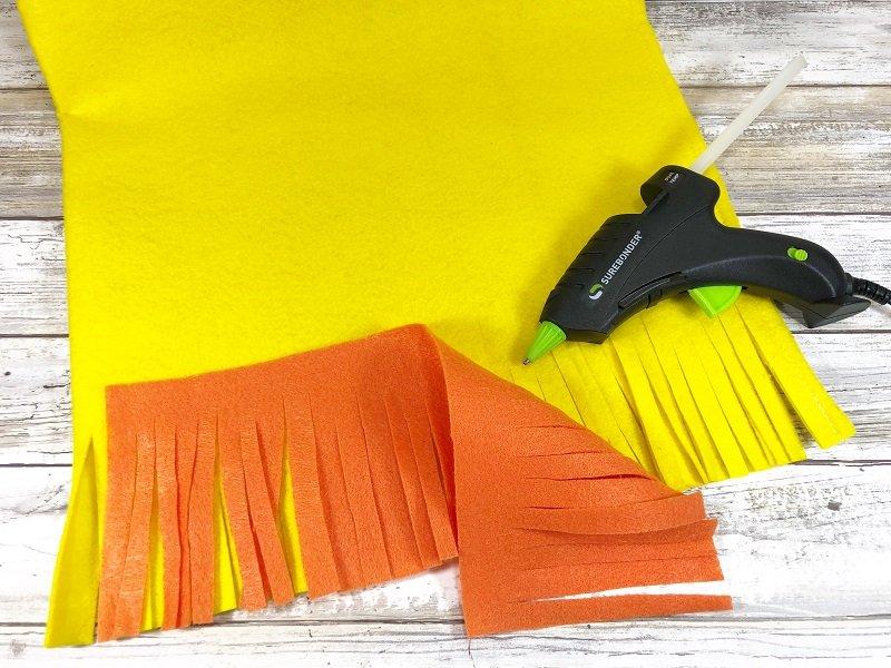 Add orange Kunin Felt fringe to chick bag Creatively Beth #creativelybeth #fairfieldworld #eastercrafts #bunny #chick