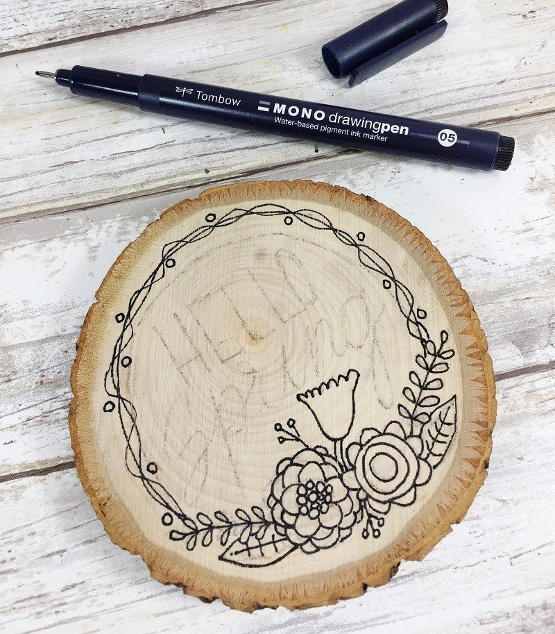 Ink in design with Tombow MONO Drawing Pen Creatively Beth #creativelybeth #woodburning #springcrafts #woodslice #doodle #handlettering
