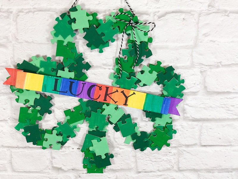 Upcycle a Lucky Shamrock Wreath from Puzzle Pieces Creatively Beth #creativelybeth #upcycle #shamrock #dollartreecraft #kidscraft #lucky