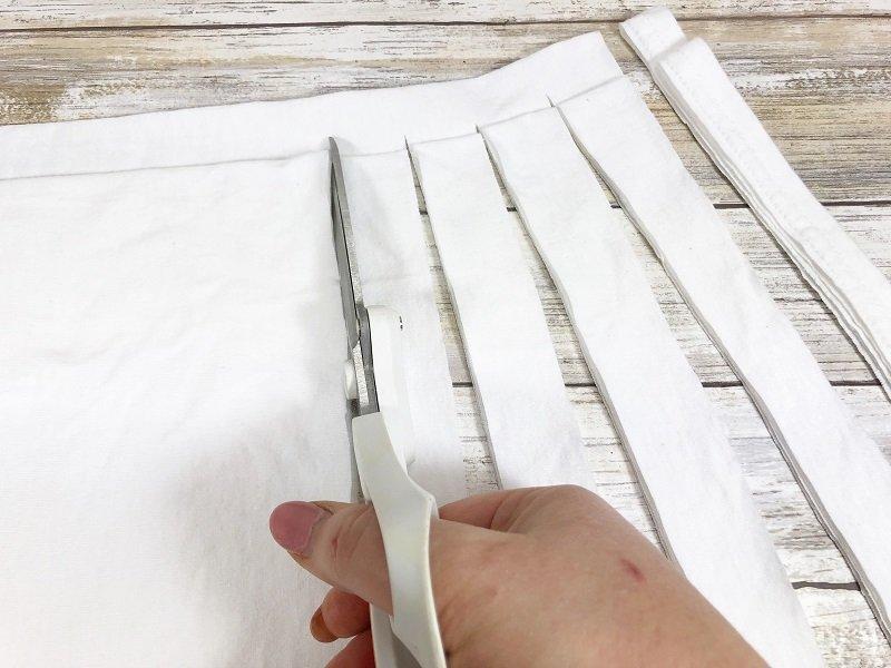Cut inch wide strips from t-shirt Creatively Beth #creativelybeth #tshirtyarn #recycledcrafts #upcycledcrafts #quickcrafts #easycrafts
