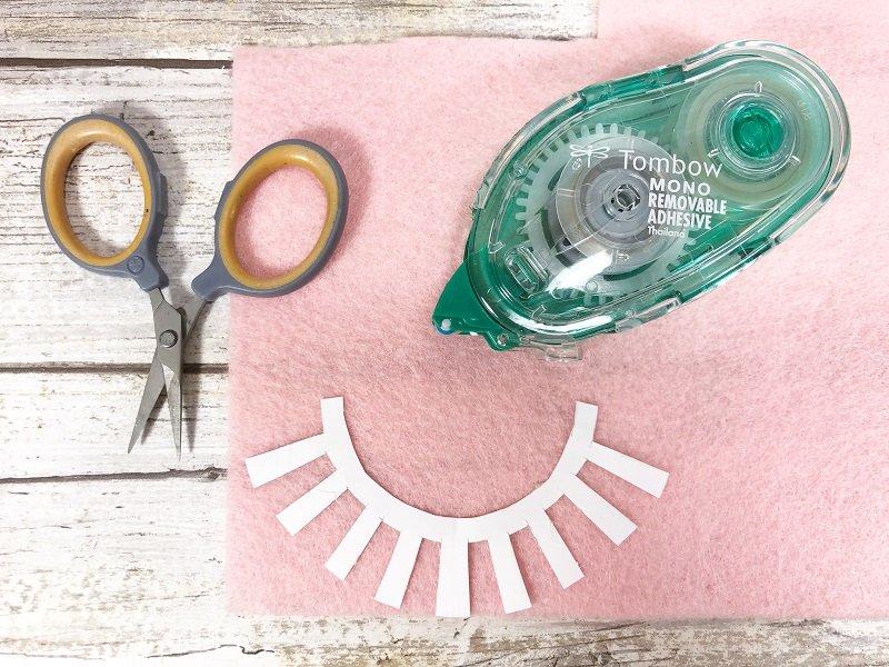 Attach eyelash pattern to Kunin Felt with adhesive runner Creatively Beth #creativelybeth #sleepmask #freepattern #easysewing #polyfil