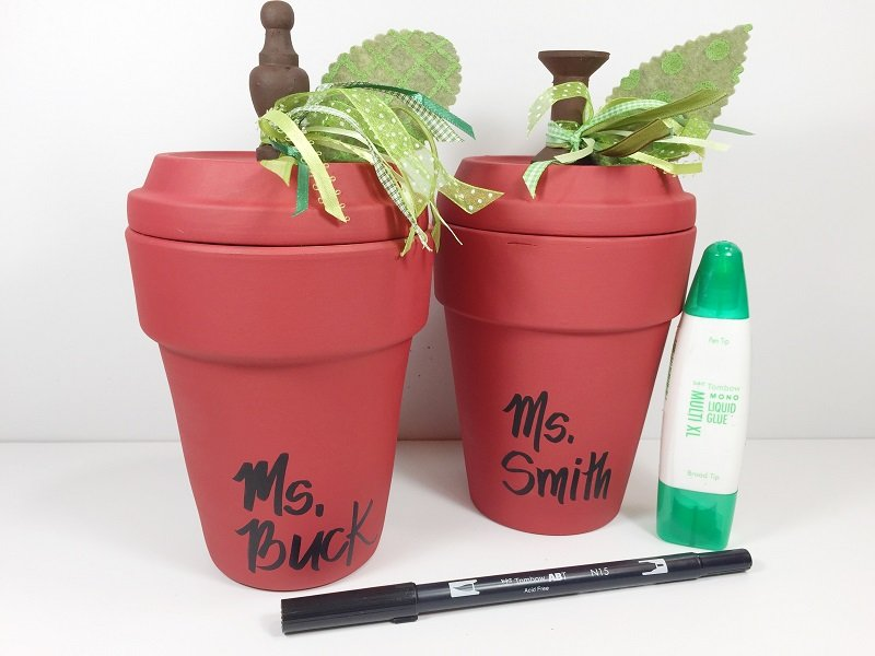 Attach to clay saucer and add ribbon accents hand letter names on clay pots Creatively Beth #creativelybeth #teacher #appreciation #gift #claypot #craft #apple #terracottapot #kidscraft