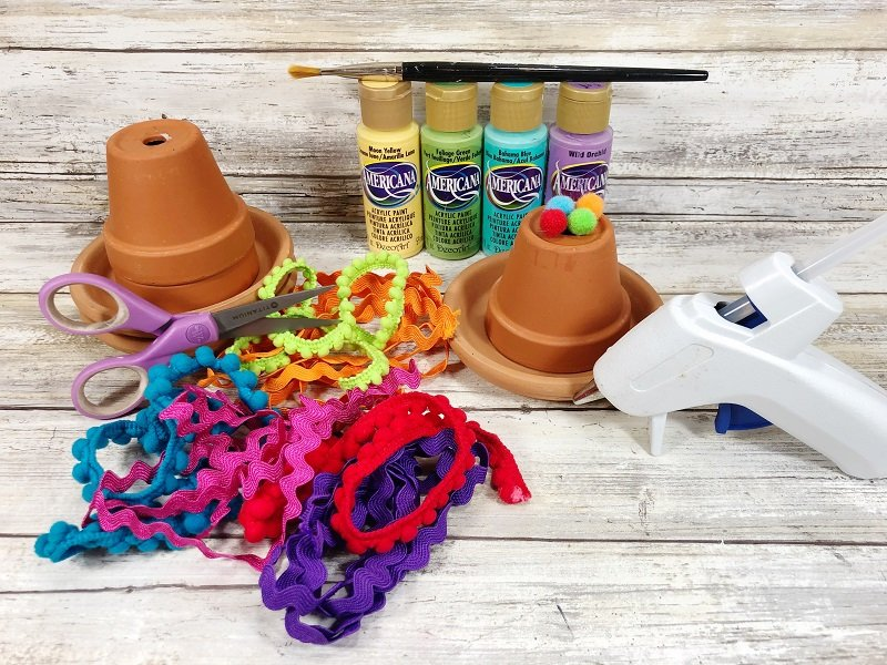Gather the supplies needed to make Sombreos with the kids Creatively Beth #creativelybeth #claypotcraft #terracottapotcraft #kidscrafts #cincodemayocraft #sombreros