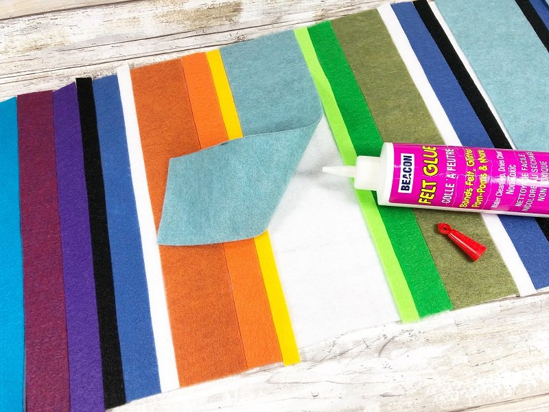 Once all strips of felt are dry fitted then glue each section to the base Creativley Beth #creativelybeth #feltcrafts #mexicanserape #tablerunner #DIY #KuninFelt #BeaconAdhesives