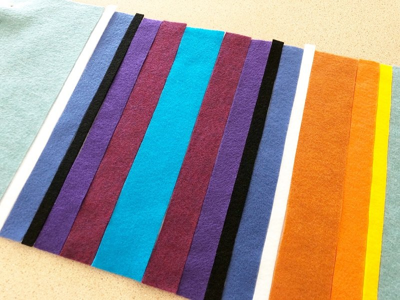 Measure and cut the multi-colored stripes for the Serape Creativley Beth #creativelybeth #feltcrafts #mexicanserape #tablerunner #DIY #KuninFelt #BeaconAdhesives