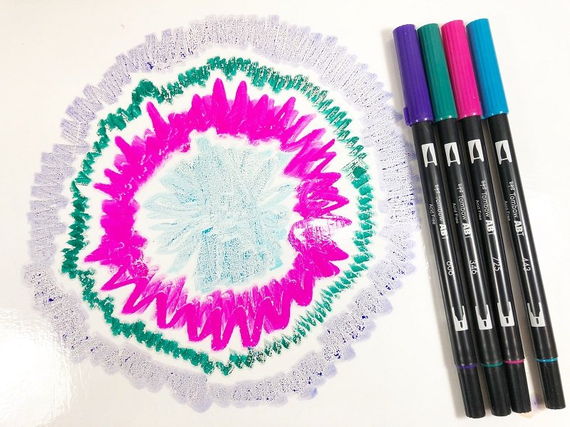Add circles of color to a plastic zippered bag Creatively Beth #creativelybeth #teidye #techniques #tombow #tombowdualbrushpens #dollartreecrafts #kidscrafts