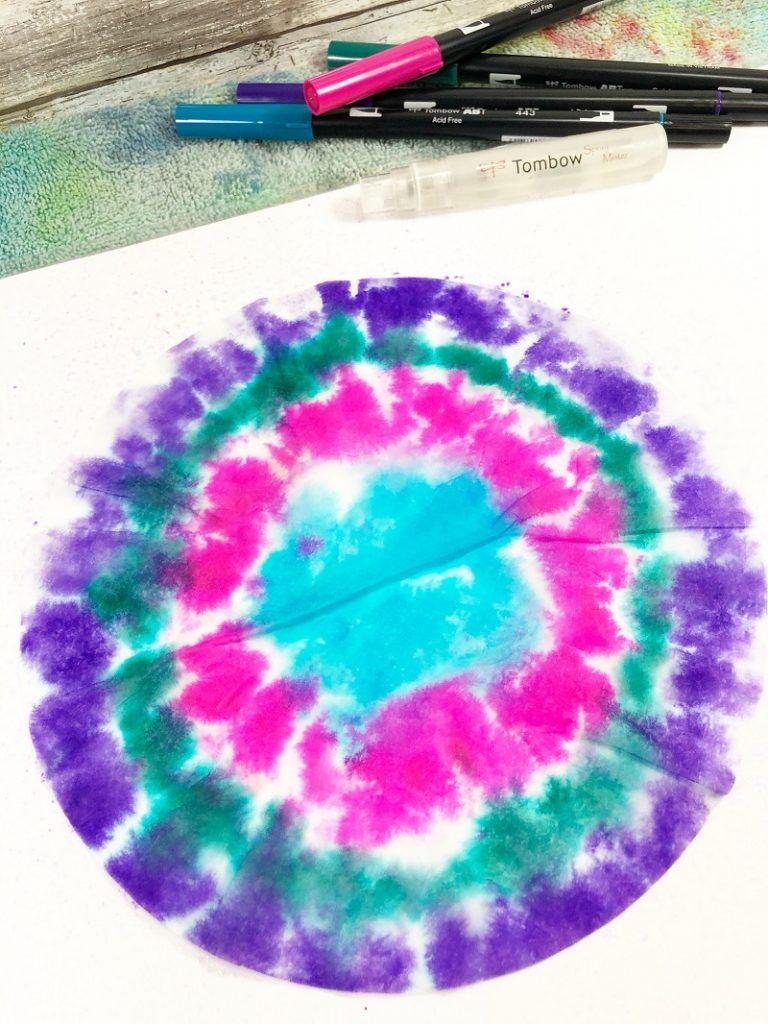 Mist with water and place coffee filter into ink Creatively Beth #creativelybeth #teidye #techniques #tombow #tombowdualbrushpens #dollartreecrafts #kidscrafts