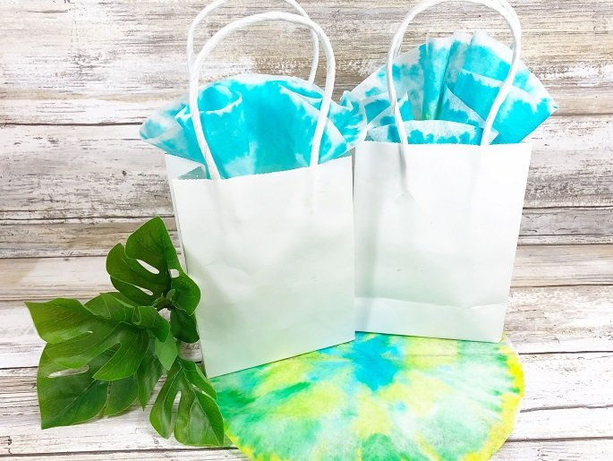 Use Tie Dye Coffee Filters instead of tissue paper in a gift bag Creatively Beth #creativelybeth #teidye #techniques #tombow #tombowdualbrushpens #dollartreecrafts #kidscrafts