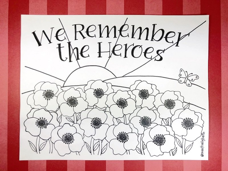 We remember the heroes hand drawn printable field of poppy flowers with a sun, sky and butterfly to celebrate Memorial Day #creativelybeth #freeprintable #memorialday #poppy
