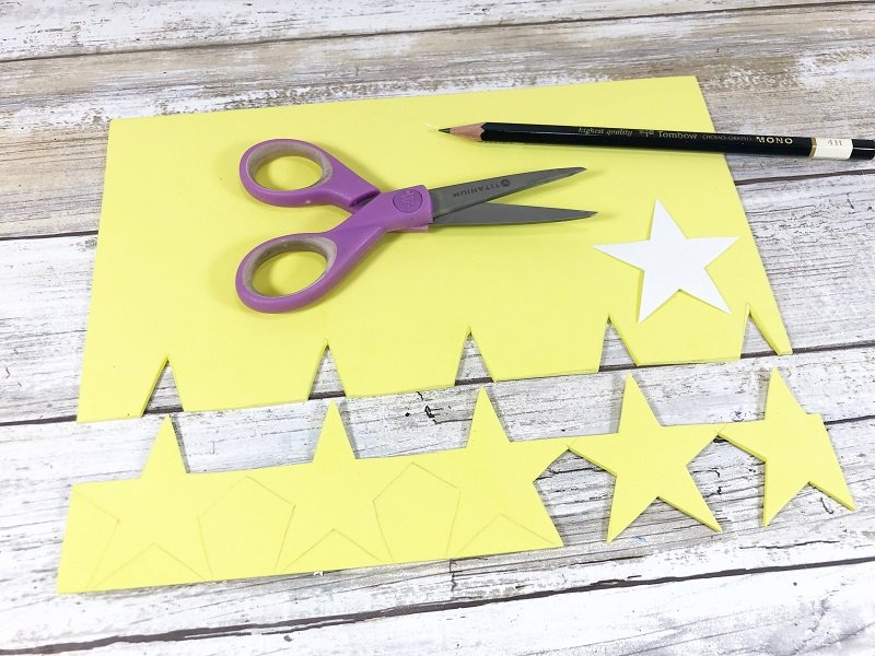 Trace and cut out a star garland from yellow craft foam Creatively Beth #creativelybeth #unclesam #upcycled #recycled #craft #patriotic