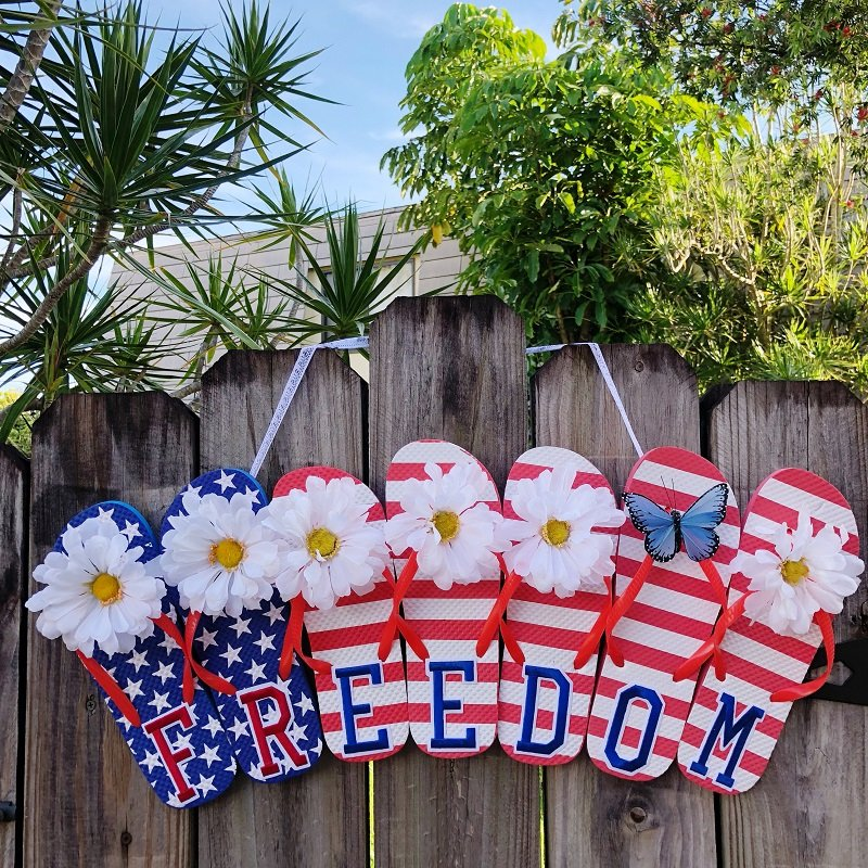 Dollar Tree Upcycled Flip Flop Freedom Sign decorated with white flowers and a blue butterfly Creatively Beth #creativelybeth #flipflopsign #freedom #recycle #upcycle #dollartree #craft