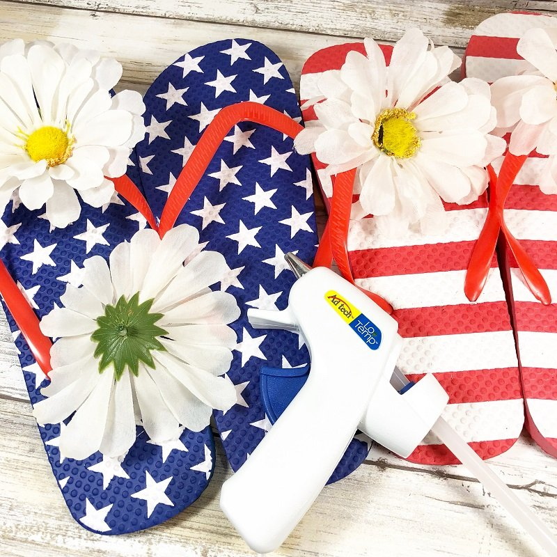 Cut apart a bunch of dollar tree daisies and glue one to each of the thongs on the top of each flip flop Creatively Beth #creativelybeth #flipflopsign #freedom #recycle #upcycle #dollartree #craft