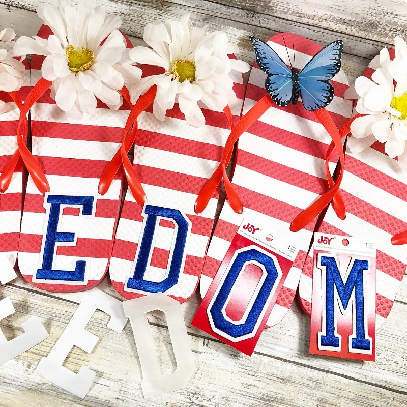 Add the letter stickers FREEDOM one to the bottom of each dollar tree flip flop Creatively Beth #creativelybeth #flipflopsign #freedom #recycle #upcycle #dollartree #craft
