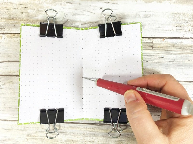 Secure inside pages to recycled notebook cover with four binder clips #creativelybeth #recycled #crafts #notebooks #journals #upcycled