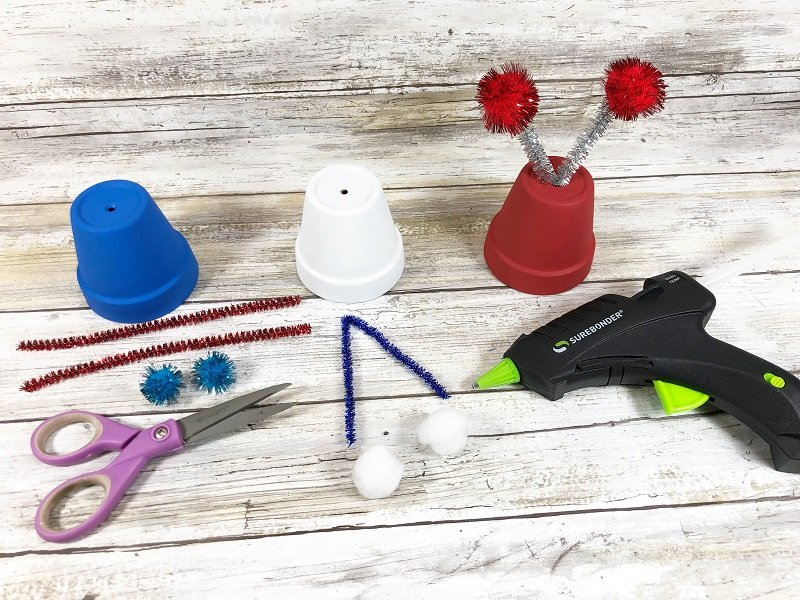 Cut tinsel chenille stems and glue pom poms to each end Creatively Beth #creativelybeth #dollartreecrafts #patrioticcrafts #claypotcrafts #fourthofjuly