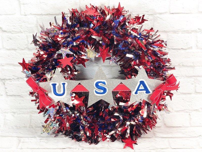 Dollar Tree Patriotic Garland Wreath by Creatively Beth #creativelybeth #patriotic #crafts #dollartree #fourthofjuly #quickandeasy