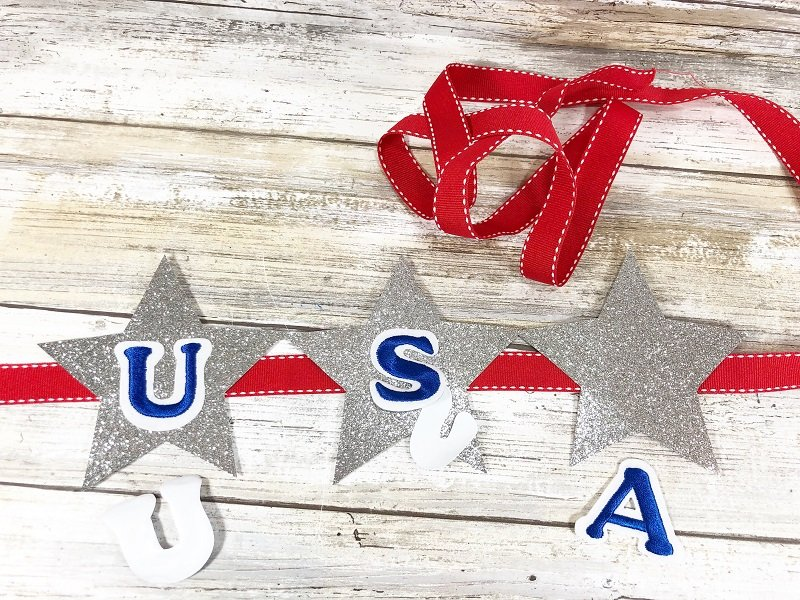 Apply blue and white letter stickers to stars Creatively Beth #creativelybeth #patriotic #crafts #dollartree #fourthofjuly #quickandeasy