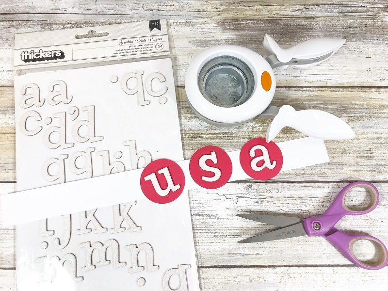 Create a banner with USA letter stickers plus red, white and blue colored papers Creatively Beth #creativelybeth #recyclecrafts #upcycledcrafts #fourthofjulycrafts #kidscrafts