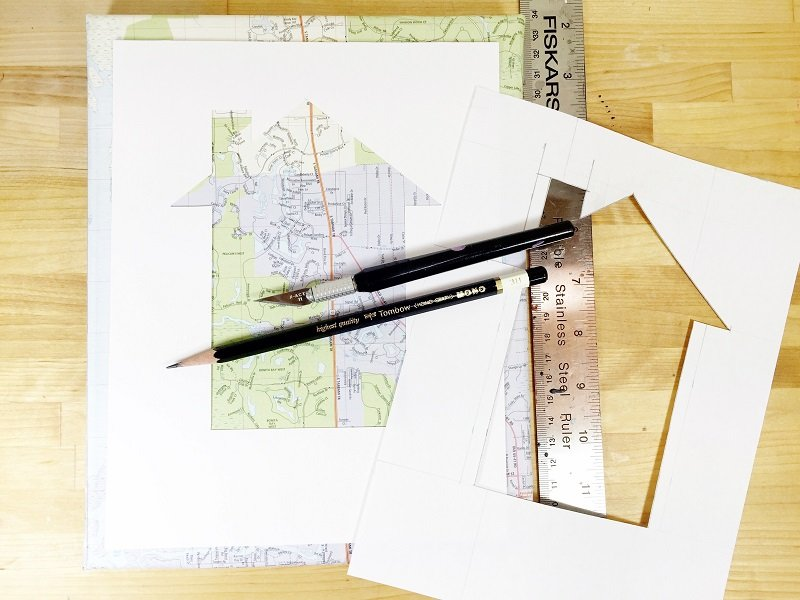 Cut a house shape from white cardstock and attach to map covered canvas with foam tape Creatively Beth #creativelybeth #upcycled #recycled #crafts #maps