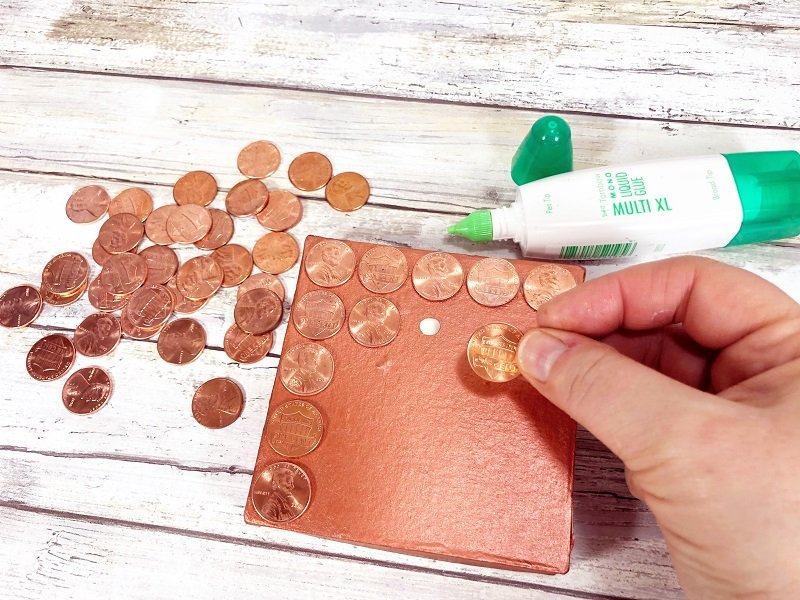 Glue pennies to the front of a gift box with Tombow MONO Multi Liquid Glue Creatively Beth #recycled #crafts #giftbox #pennies #penny