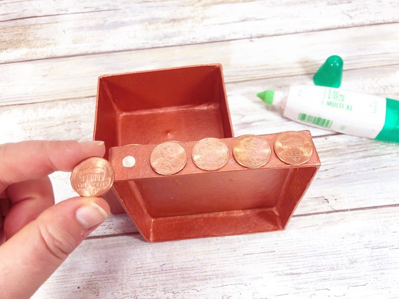 Glue pennies to the sides of a gift box with Tombow MONO Multi Liquid Glue Creatively Beth #recycled #crafts #giftbox #pennies #penny