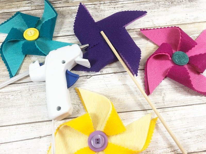 Secure wooden dowel to the back of each pinwheel with glue Creatively Beth #creativelybeth #kidscrafts #feltcrafts #summer #pinwheels