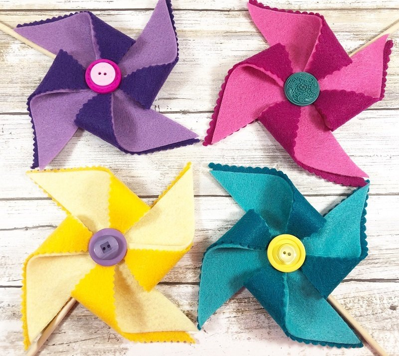 Yellow pink purple and turquoise colorful pinwheels for Summer Creatively Beth #creativelybeth #kidscrafts #feltcrafts #summer #pinwheels