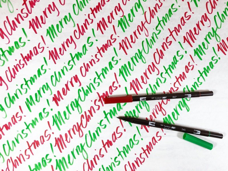 Hand lettering the words Merry Christmas on plain white butcher paper creates the perfect wrapping paper Creatively Beth #creativelybeth #christmas #wrappingpaper #tombowdualbrushpens #doodle #plaid #handlettering