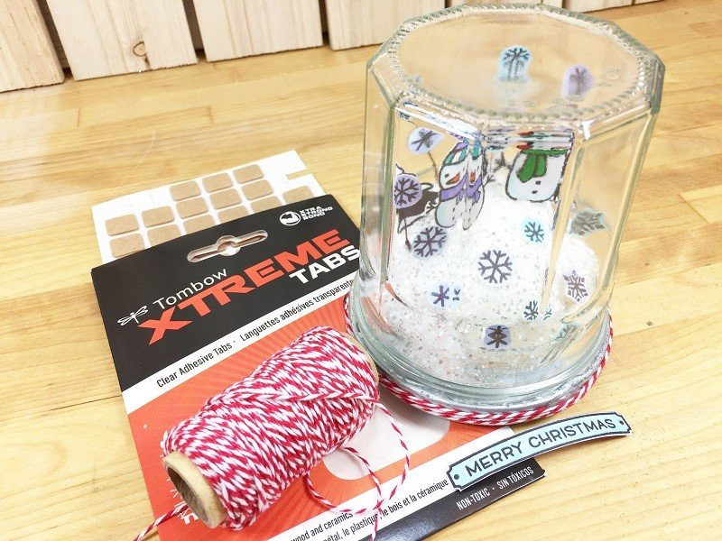 Embellish with stamped message and baker's twine Creatively Beth #creativelybeth #snowglobe #tombowdualbrushpens #christmascrafts