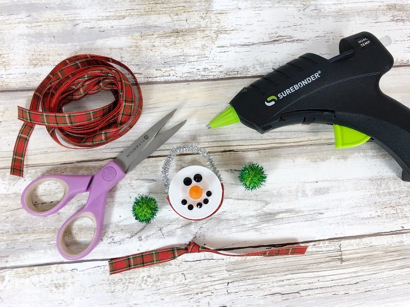 Assemble the snowman with a glue gun Creatively Beth #creativelybeth #dollartreecrafts #christmas #ornaments
